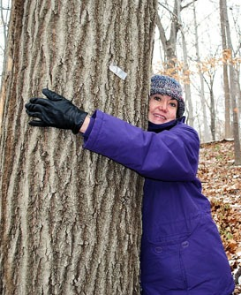 Caren hugging a tree sized for web